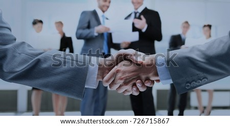 Business handshake and business people - Shutterstock ID 726715867