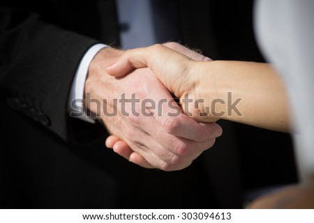 Business handshake and business people. Business handshake for closing the deal after singing the lucrative contract between companies.