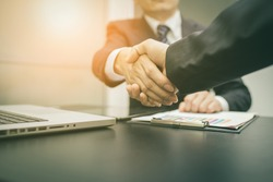 Business handshake and business people on deal concept. vintage tone.