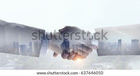 Business handshake as symbol of deal #637646050