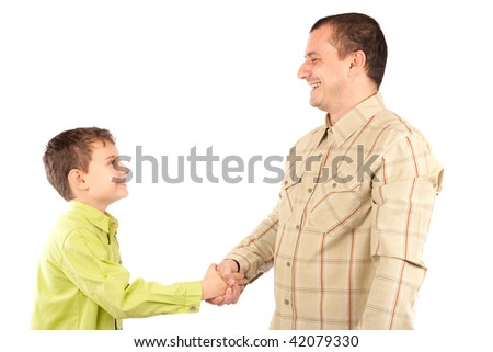 Business handshake between father and son