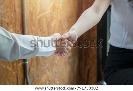 Business handshake, businessman, businesswomen. Business concept. Business handshake and business people. Agreement by doing handshake.  #791738302