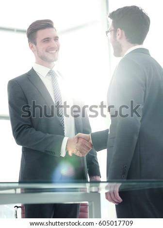 Business handshake. Close-up of business men shaking hands #605017709
