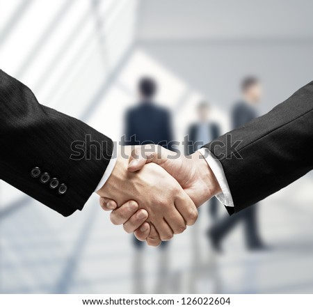 business handshake in loft room