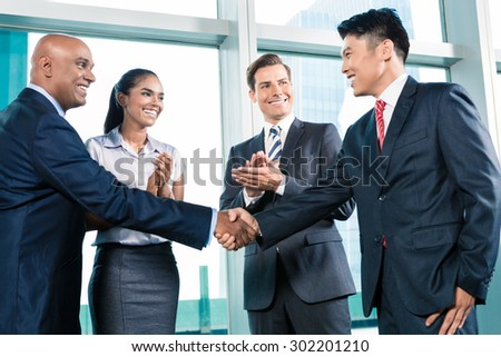 Business handshake in lofty office with city view, a deal is struck  #302201210