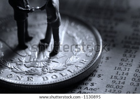 Business handshake on a silver dollar