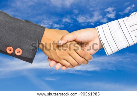 Business handshake on sky background, greeting or agreement concept