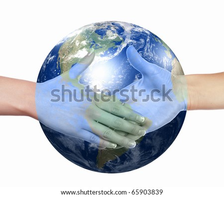Business handshake on the background of the Earth. The symbol of a successful business.