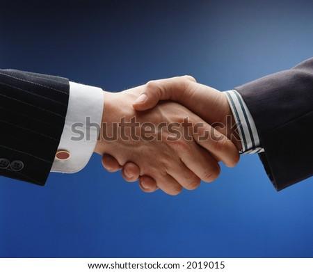 business handshake over blue background