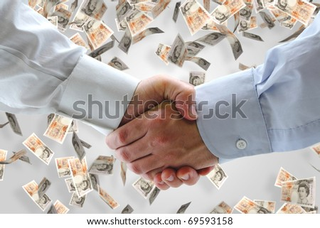 Business handshake with falling money in background