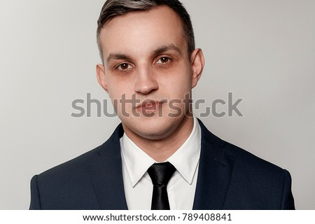 business, health, people, and lifestyle concept - Portrait of handsome man in black blue suit. dark circles under eyes men. Portrait of concentrated or depressed businessman. #789408841