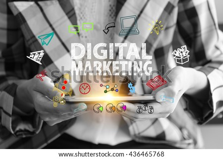 business holding a smart phone with DIGITAL MARKETING  text on black and white background ,business analysis and strategy as concept
