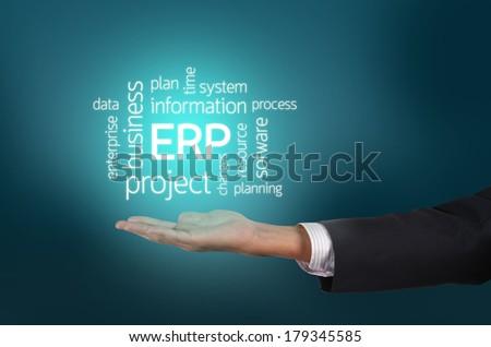 Business holding Enterprise resource planning (ERP) cloud concept wording - stock photo