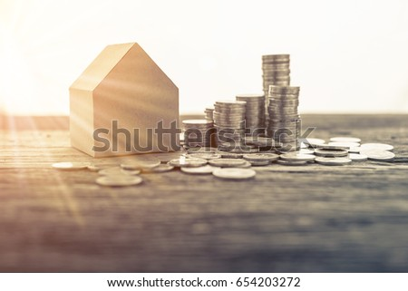 business house investment ideas concept with coin money stack with house paper model #654203272