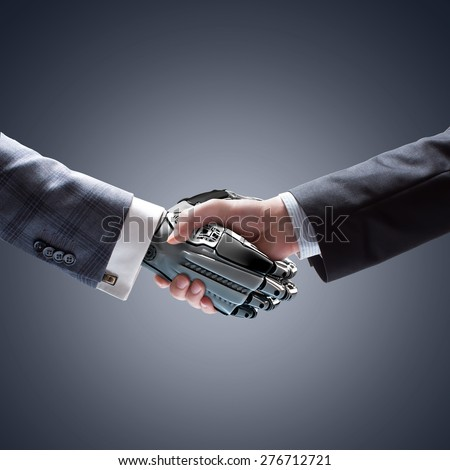 Business Human and Robot hands in handshake. Artificial intelligence technology Design Concept
