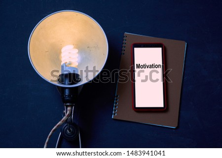 Business idea, individuality and creativity. Success and motivation. Vintage lamp, smartphone and notebook