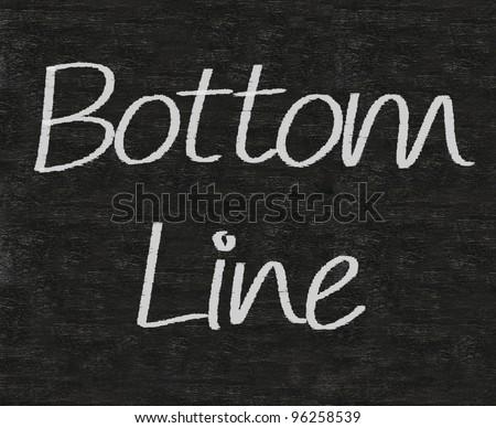 business idioms written on blackboard background, bottom line
