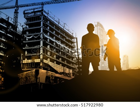 Business Industrial,People,personal and career growth silhouette Businessman engineer looking blueprint in a building site over Blurred construction site film grain progress and potential concepts.