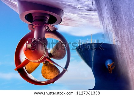 Business industry floaing dock for cargo ship Repair success of propeller in shipyard on blue sky background