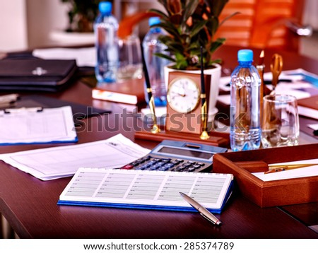 Business interior on table with clock and leather chair in office. Top view.