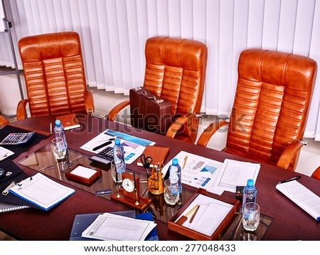 Business interior with  table and leather chair in office. Top view.