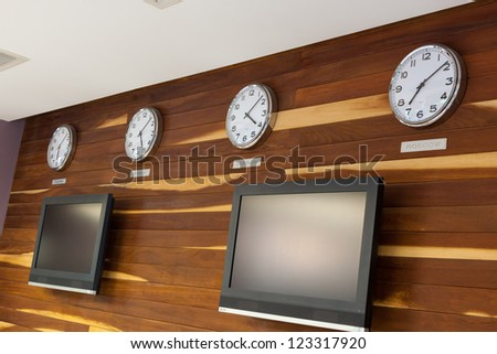 Business Interiors wooded wall with flat TV or LCD screen and Worldwide Clocks-Time
