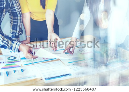 BUSINESS Investment Advisory Meeting PARTNER TEAM A์alyzes Company's Annual Financial Statements. Balance Sheets Work With Graph papers. REPORT AUDIT, TAX ,Investment Analysis for Shareholders