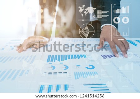 Business Investment Advisory TEAM Analyzes COMPANY's Annual Financial Statements.Balance SPREADSHEETs Work with Graph Papers.Concept of internal AUDIT TAX return on Investment Analysis Shareholders