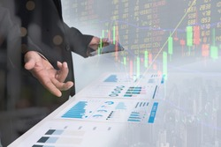 Business Investment Advisory TEAM Analyzes Company's Annual Financial Statements.Balance Sheets Work with Graph Papers. Concept of internal audit , Tax Return on Investment analysis Shareholders