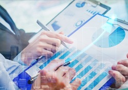 Business Investment Advisory Team Analyzes company's annual financial Statements. Balance sheets work with graph papers.concept of internal Audit, tax,return on investment analysis Shareholders and