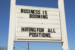 Business is booming sign in Austin, Texas market