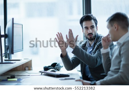 Business IT colleague explaining project details in office