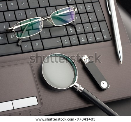 Business items on laptop computer