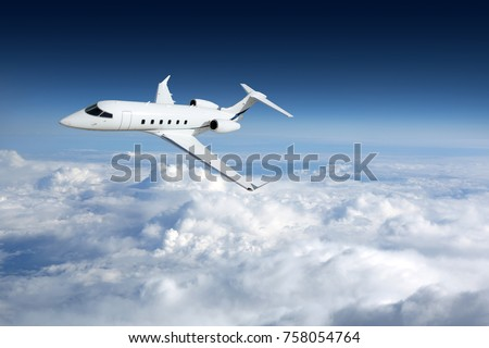 Business jet airplane flying on a high altitude above the clouds #758054764