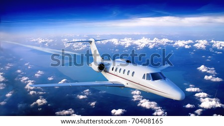 business jet flying above a lake