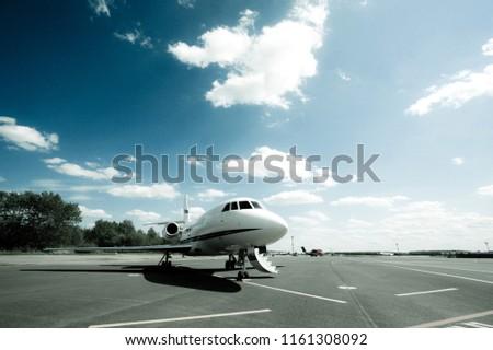 Business Jet with open door waiting for passengers #1161308092