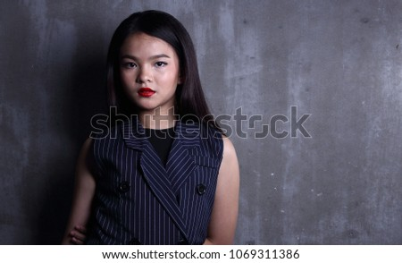 Business Kid Girl in formal suit stand on dark abstract background, studio lighting copy space for text logo, black hair eleven years old portrait half body #1069311386