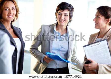 Business ladies laughing at the joke in the midst of the discussion
