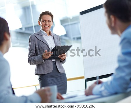 Business lady presenting a project to her colleagues
