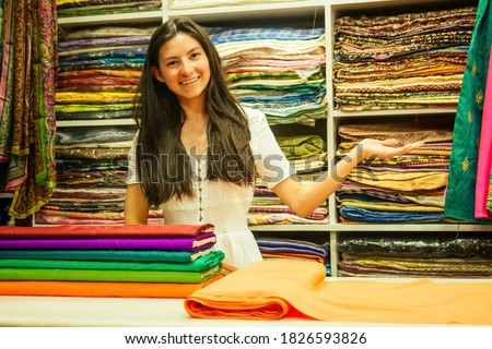 business lady shop owner cashmere yak wool shawls.female seller in goa india Foto d'archivio ©