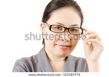 Business lady touching her glasses for think with her work.