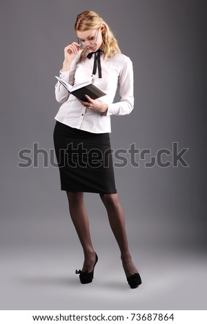 Business lady with glasses and literature