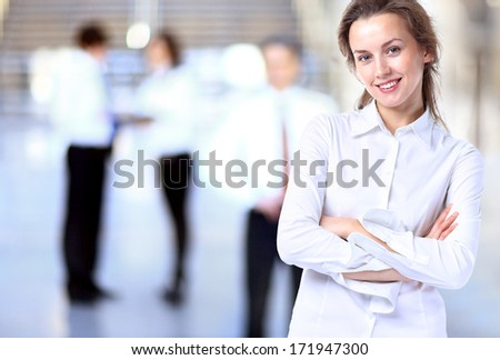 Business lady with positive look and cheerful smile posing for the camera #171947300