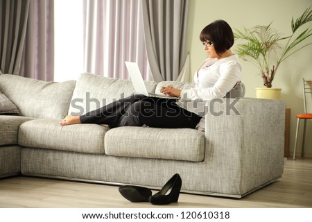 business lady working on her laptop - stock photo