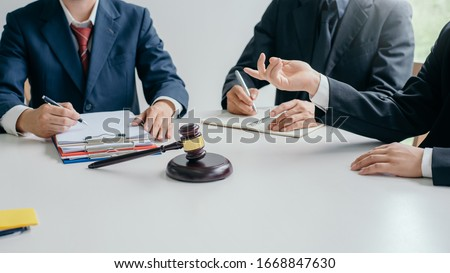 Business lawyer working about legal legislation in courtroom to help their customer. Foto stock ©