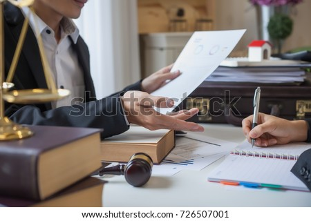 Business lawyer working about legal legislation in courtroom to help their customer #726507001