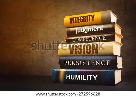Business Leader Attributes, Traits, Characteristics and Features in Education Literature, Mastering Leadership Concept with Stack of Published Books.