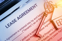 Business lease agreement concept : Pen and keychain on a lease agreement form. Lease agreement is a contract between a lessor and a lessee that allow lessee rights to use of a property owned by lessor