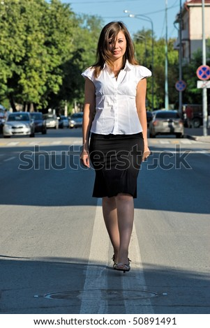 Business like a road. Businesswoman walking on central line of road