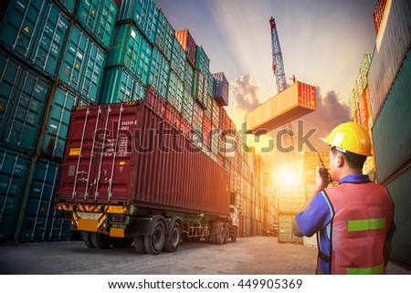 Business logistic concept, Foreman control loading Containers box to truck for Logistic Import Export Background